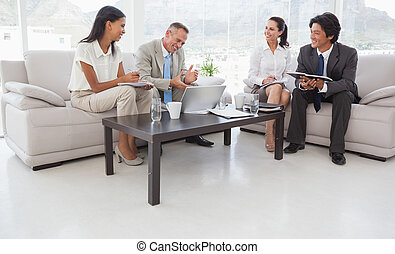 Hard working business people sitting down