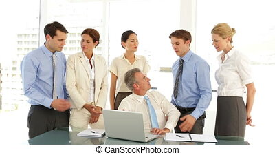 Hard working business team talking in front of laptop at the office