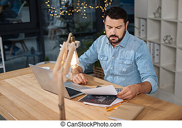 Hard working handsome businessman working with documents