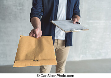 Hard-working man is carrying parcel