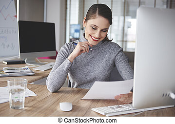 Hard working woman in office building