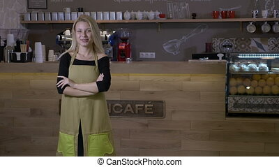 Hard working young blonde woman finally opens her own cafe...