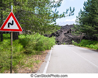 hardened lava flow closed road on slope of Etna