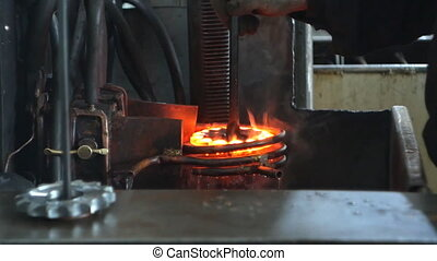 Hardening and heat treatment of the metal gear of the part ...