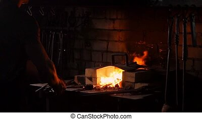 Hardening of the metal by sharp cooling in water. There is ...