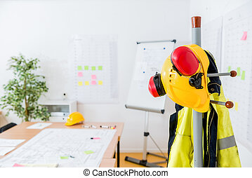 Hardhat And Earmuffs On Rack In Office