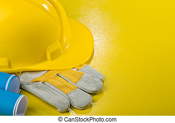 hardhat glove and blueprints