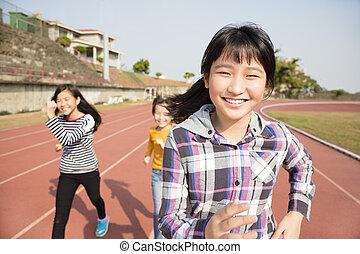 hardloop wedstrijd, rennende , meiden, tiener, vrolijke
