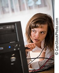 Hardware problems - woman repairing computer