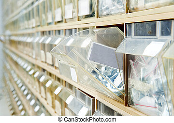 Hardware store shelves - Endless rows of hardware in...