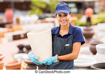 hardware store worker holding plant pot