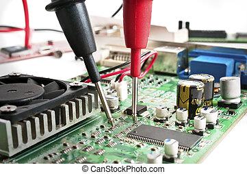Hardware testing - Multimeter probes examining a computer...