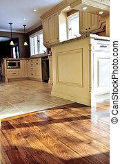 Hardwood and tile floor - Hardwood and tile floor in...