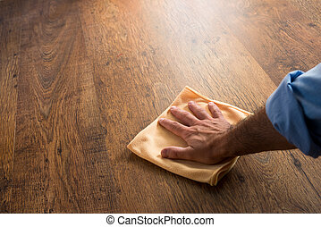 Hardwood floor manteinance - Male hand cleaning and rubbing...