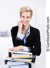 Hardworking attractive blond businesswoman