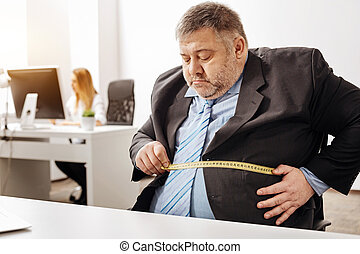 Hardworking employee suffering from excess weight - Not...