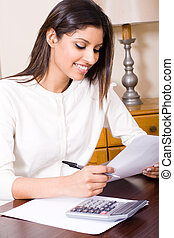 hardworking woman - a hardwdorking woman at her desk with...