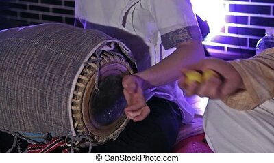 Hare Krishna Man Playing Traditional Indian Instrument Mridanga Close-up.