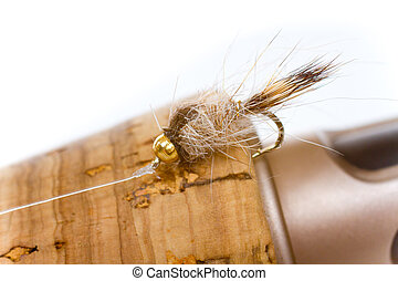 Hares Ear Nymph on Fly Rod - Isolated in a studio with a...