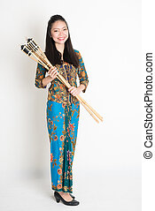 Hari raya - Full body portrait of Southeast Asian girl in...