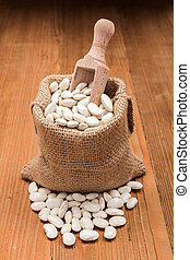 Haricot beans in burlap bag