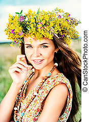 harmonious life - Romantic girl in a wreath of wild flowers ...