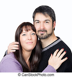 harmonious marriage - happy couple standing together against...