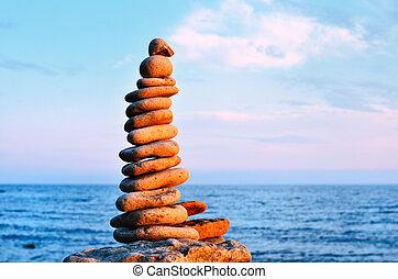 Harmonious - Balancing of stones each other on the seashore