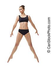 Harmonous ballet dancer posing in graceful jump - Harmonous...