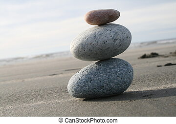 Harmony - Balanced round stones on a beach.