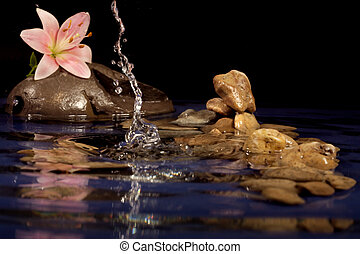 Composition for a relaxation from sea stones and a lily.