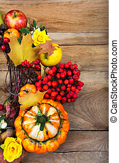 Harvest background with decorative pumpkin on the wooden table, copy space