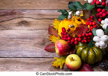 Harvest background with snowberry, green and yellow squash