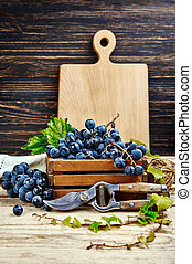 Harvest blue grapes in box copyspace vine
