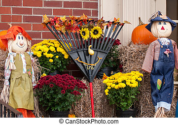 harvest decorations next to a brick building
