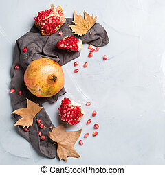 Harvest fall autumn concept. Ripe juicy pomegranate