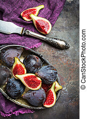 Harvest fall autumn concept. Ripe juicy violet figs