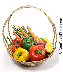 A basket of colorful harvest fresh vegetables. White background.