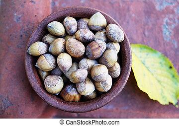 harvest nuts in a ceramic bowl