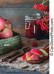 Harvest of apples in the basket prepared for cooking in the fall on the table. Village