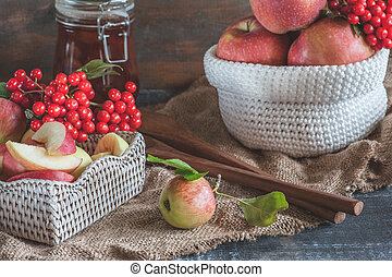 Harvest of apples in the basket prepared for cooking in the fall on the table. Village.