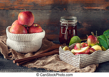 Harvest of apples in the basket prepared for cooking jam in the fall on the table. Rustic.