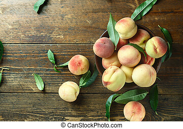 harvest of ripe peaches on the table
