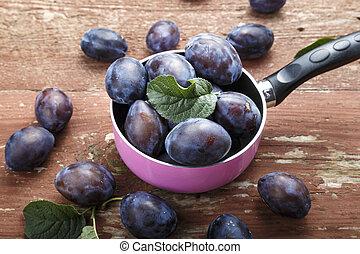 harvest of ripe plums