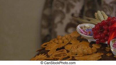 Harvest of viburnum berries on a table. Fresh berries...
