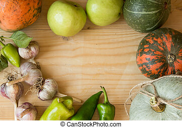 Harvest or Thanksgiving background with autumn fruits and gourds on a rustic wooden table