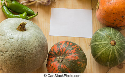 Harvest or Thanksgiving background with autumn fruits and gourds on a rustic wooden table,copy space