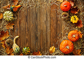 Harvest or Thanksgiving background with gourds and straw on...