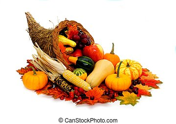 Harvest or Thanksgiving cornucopia filled with vegetables on a white background