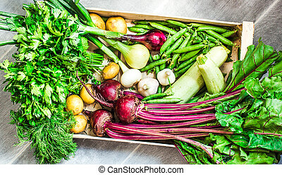 Harvest organic fresh vegetables in a wooden box.